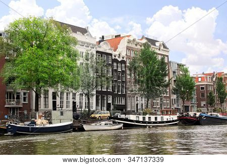Romantic medieval houses along the river canal in Amsterdam, capital of Netherland, Europe