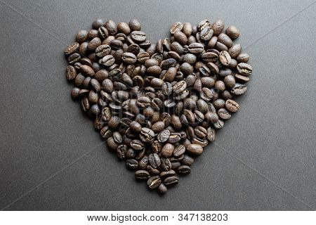 Heart Shape Made Of Roasted Coffee Beans On Dark Background
