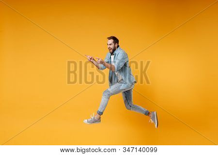 Funny Young Bearded Man In Casual Blue Shirt Posing Isolated On Yellow Orange Background Studio Port