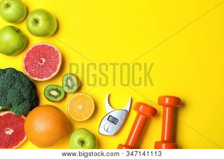 Fruits, Vegetables, Dumbbells And Digital Caliper On Yellow Background, Flat Lay With Space For Text