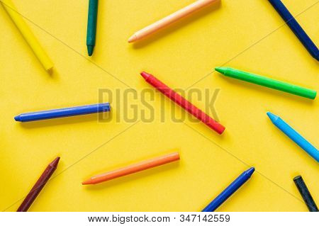 Yellow Background With Colorful Wax Pastel Crayon Pencils