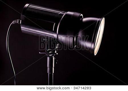 studio light strobes on black background
