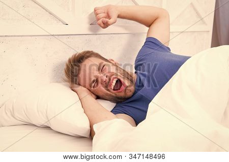 Comfortable Place To Pass Out. Sexy Man Lying In Comfortable Bed. Handsome Guy Yawning And Feeling C
