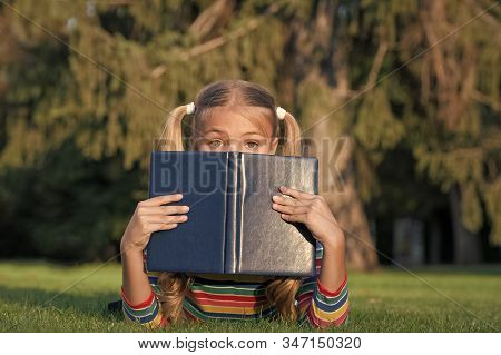 Dont Judge Book By Its Cover. Adorable Small Child Cover Face With Book. Cute Little Girl Read Book