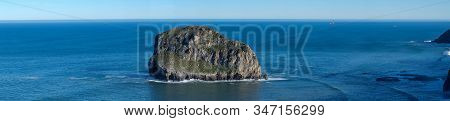 Panoramic View Of A Lone, Lonely Stone In The Ocean, Sea On Sunny Day On Background Of Blue Sea And