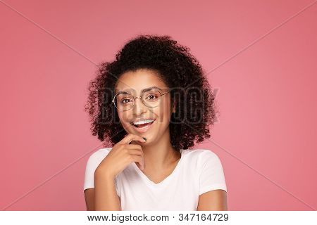 Happy African American Student Woman Smiling. Beautiful Female Showing Empty Space. Young Emotional