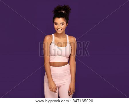 Fit Beautiful Afro American Woman Posing In Sporty Clothes In Studio. Smiling Girl Exercising. Healt