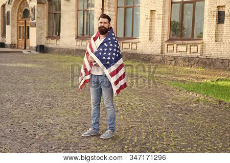 The Authorisation. Bearded Man Getting Visa Of The United States. Visa Applicant Wearing Usa Flag On