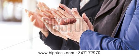Successful Group Of Business People Clapping Hands In The Meeting In Modern Office.partnership Appro