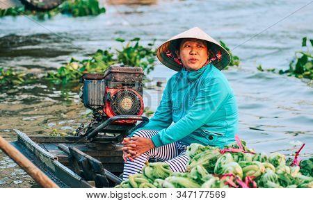 Portrait Of Vendor At Nga Nam Floating Market