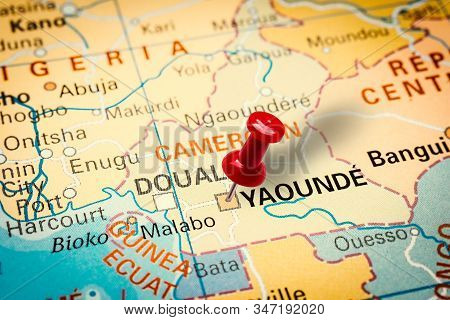 Prague, Czech Republic - January 12, 2019: Red Thumbtack In A Map. Pushpin Pointing At Yaounde City