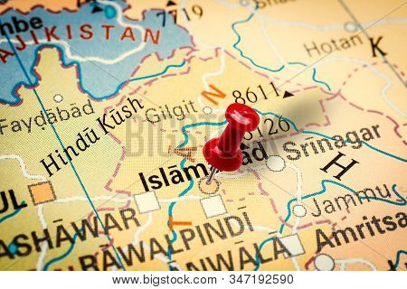Prague, Czech Republic - January 12, 2019: Red Thumbtack In A Map. Pushpin Pointing At Islamabad Cit