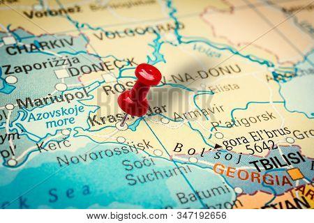 Prague, Czech Republic - January 12, 2019: Red Thumbtack In A Map. Pushpin Pointing At Krasnodar Cit