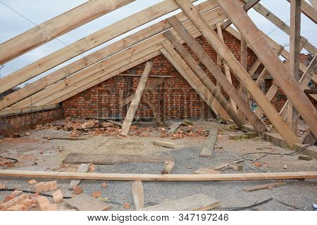 Incomplete Attic House Roof Wooden Frame Construction.  Unfinished Attic House Rooftop Roofing Const