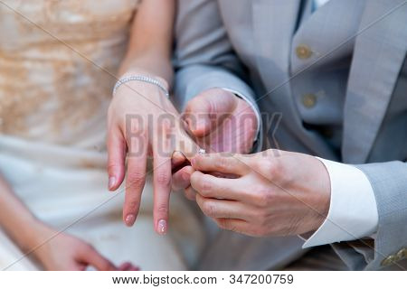 Happy Moment Of Exchanging (giving And Receiving) Diamond Engagement Rings During Traditional Marria