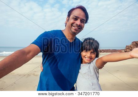 Smiling Indian Father And Child Taking Selfie Together Looking At Camera, Head Shot Portrait Of Happ