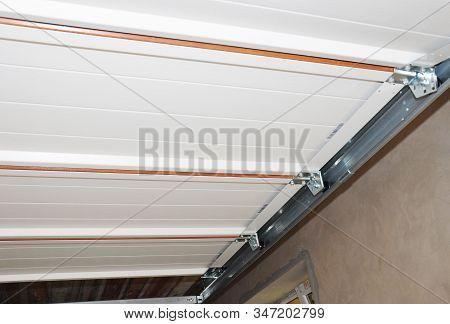 Garage Door Opener, Post Rail, Rollers Repair.  Close Up On Garage Door Installation.
