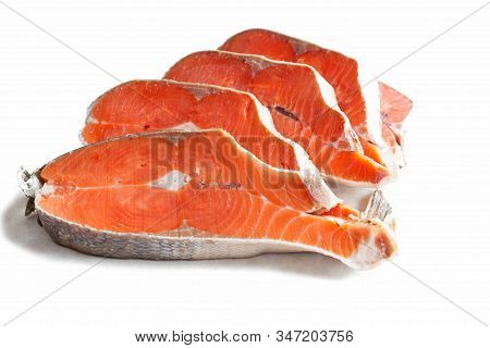 Delicious Steaks Of Coho Salmon Fish After Freezing Before Cooking In A Restaurant Or Kitchen. Whole