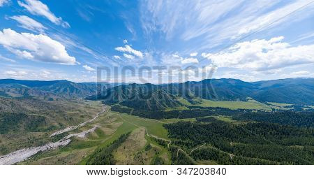 Aerial Panoramic Wide Banner View Of A Chike-taman Pass In The Altai Mountains With Green Trees, Blu