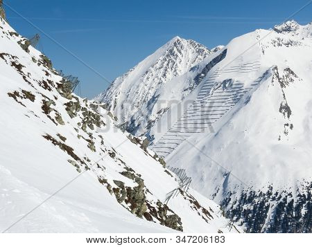 Avalanche Protection Barriers In The Zillertal Alps. Essential To Protect The Lokal Population And W