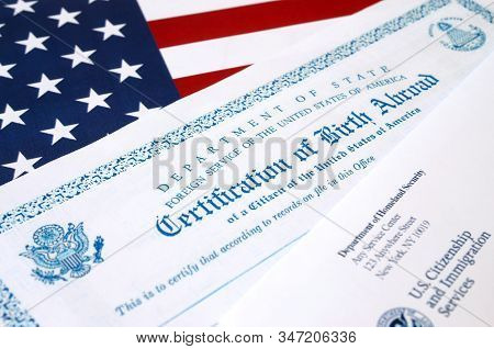 Fs-545 Certification Of Birth Abroad Lies On United States Flag With Envelope From Department Of Hom