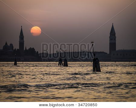 An image of a sunset in Venice Italy