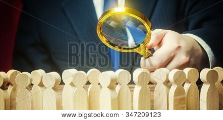 Businessman Is Studying A Crowd Of People With A Magnifying Glass. Hr Search Candidates For Work, St
