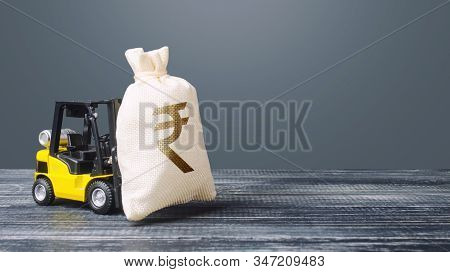Forklift Carries A Indian Rupee Money Bag. Major Contract, Contractor, Profitable Deposit, Loan. Inf