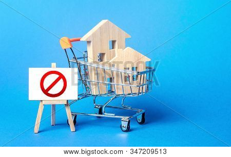 Houses In A Shopping Cart And Easel Red Prohibition Sign No. Inaccessibility, Lack Housing, Deficit.