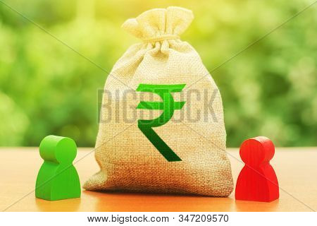 Indian Rupee Money Bag And Two Businessmen. Business Investment, Lending, Leasing. Dispute Solution