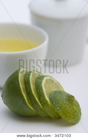 Tea serving in white cup with spoon and lime sliced poster