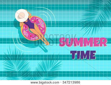 The young woman swims in the pool top view. A woman swims in a pool on an air mattress, enjoying summer vacation. Summer time. Hello Summer, summer time, summer day, summer day background, summer banners, summer flyer, summer design, summer with people in