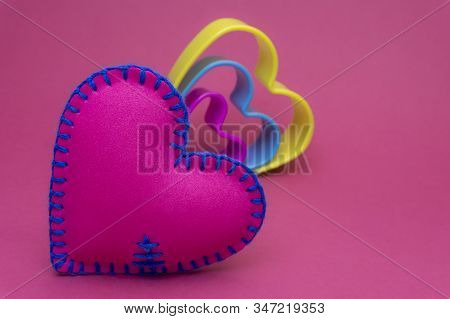Romantic Still Life With Hand Sewn Textile Pink Heart And Nested Colorful Hearts Shapes On Pink With