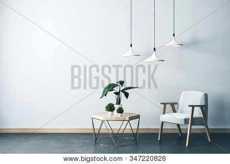 Modern Living Room Interior With Armchair, Small Table With Plants And Lamps. Style And Design Conce