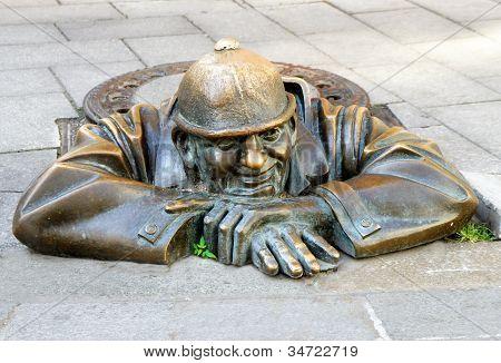 Bronze Sculpture Man At Work Alias Cumil In Bratislava