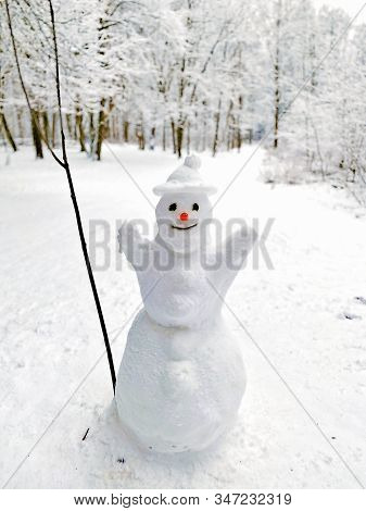 Snowman In A Snow-covered Forest. Winter Fun