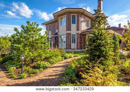 Moscow Region - Aug 24, 2019: Landscape Design At Residential House. Beautiful Landscaping With Pave