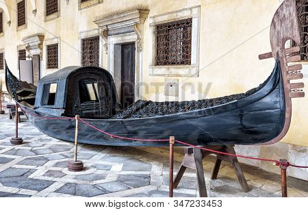 Venice - May 20, 2017: Vintage Gondola In Courtyard Of Doge`s Palace Or Palazzo Ducale, Venice, Ital