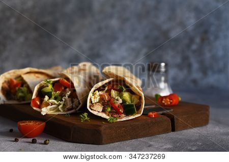 Burrito - Mexican Dish With Corn Tortilla, Jasse, Vegetables And Sauce. Tortilla Stuffed.