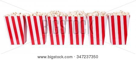 Popcorn in red and white stripes cardboard boxes for cinema or TV