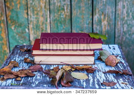 Pile Of Books On The Old Table Outdoor