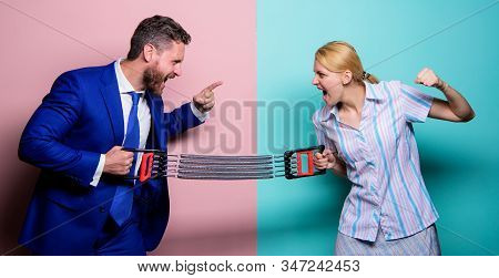 Business Couple Spring Expander. Property Division. Man Against Woman. Battle Between Male And Femal