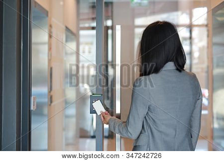 Young Officer Woman Holding A Key Card To Lock And Unlock Door For Access Entry. Door Access Control