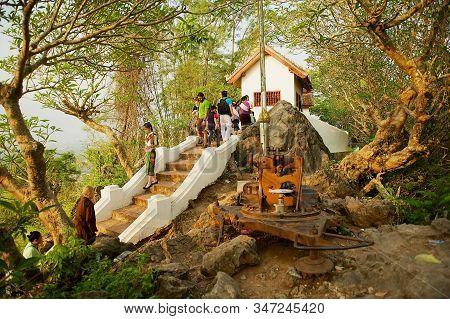 Luang Prabang, Laos - April 15, 2012: People Visit Wat Chom Si Temple At Phou Si Hill In Luang Praba