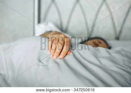 Close-up Hand Of A Girl Who Sleeps In Bed Early In The Morning Or Rests During The Day Or On The Wee