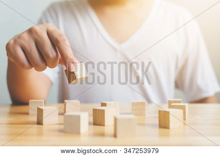 Brain Therapy Rehabilitation Cognitive Psychological Testing. Hand Holding Wood Block Cube Therapy E
