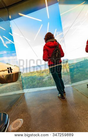 Tourist Woman Look Out At The Sea Coast Landscape From The Inside Of Mirrored Toilet Bukkekjerka Res