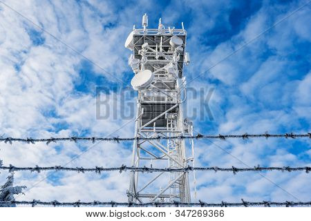 Frozen Telecommunication Mast With Antennas High In The Mountains