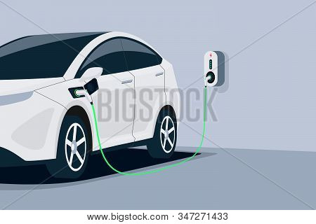 Electric Car Charging In Underground Garage Home Plugged To Charger Station. Battery Ev Vehicle Stan