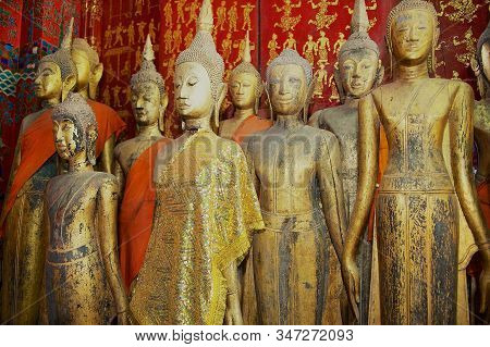 Luang Prabang, Laos - April 16, 2012: Buddha Images In A Small Red Color Hall Of Wat Xieng Thong Or